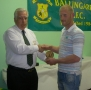 Denis Kelly receives his award from Moss Doody on entry to the '200' club.