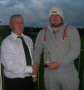 Pat Kenrick receives his award from John Clancy on entry to the '200' club.