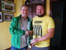 Patrick Kenrick receiving his award for 300 appearances from John Cronin