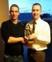 Aidan Barrett receives his 200th appearance award from club Treasurer Rory Alymer.