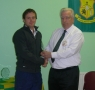 Colm Kiely receives his award from Club President Moss Doody on achieving 300 appearances.