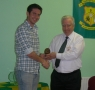 Darragh O'Grady receives his award from Club President Moss Doody on achieving 200 appearances.