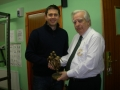 Darragh O'Grady receives his award from Club President Moss Doody on achieving 300 appearances.