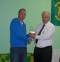 Eoin Barrett receives his award from Club President Moss Doody on achieving 300 appearances.