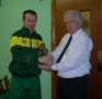 Francis Kiely receives his award from Moss Doody on entry to the '200' club.