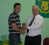 Niall Condron receives his award from Club President Moss Doody on achieving 200 appearances.