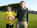Captain Brian Sheehy receives cup from John Phillips of the LDSL