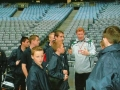 The FAI's Will Clark gives the ballboys a run-through prior to kick-off.