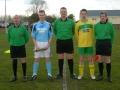 Ballingarry captain Aidan Barrett presents club pennant