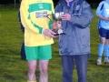 Captain Aidan Barrett accepts cup from  LDFL rep Frank Nelligan