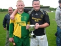 Man of the Match Denis Kelly and Captain Patrick Kenrick with the Division 1 League Cup