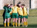 The girls engage in their 'huddle' before kick-off