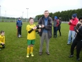 Captain Cathal McMahon accepts cup from John Phillips LDSL