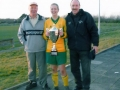 Ballingarry AFC Ladies Captain Rachel Hickey shows off the cup with team managers John Cagney and Davy Fitzgerald.