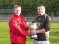 Patrick Kenrick receives Division 1 trophy from PJ Hogan