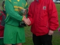 Brian Fitzgerald receives cup from PJ Hogan of the Desmond League