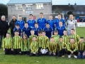 The Ballingarry U-12 team and managers pose with the Limerick FC team before kick off