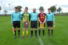 Captains Kieran Tagney Ballingarry and Leon Kelly Bridge United with match officials