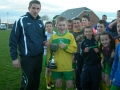 Killian Begley presented with Under 12 cup by Tom Ambrose