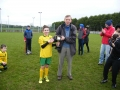 Captain Cathal McMahon accepts the cup from John Phillips