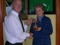 Crissie Danaher presenting the Mikey Danaher Perpetual Player of the Year trophy to the club chairman Pascal Moynihan