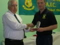 Eoin Kennedy receiving 50 goal award from Moss Doody
