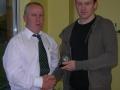 Francis Kiely receives award from John Clancy on reaching 50 goals.