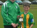 Ballingarry U-13 Captain Mikey Hickey accepts cup from Tom Ambrose
