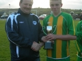Captain Mikey Morrissey receives the cup
