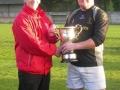 Captain Pat Kenrick receives Division 1 cup