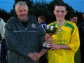 Captain Sean Lenihan receives cup