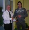 Brian receives award from John Clancy