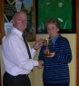 Crissie Danaher presenting the Mikey Danaher Perpetual Cup to Chairman Paschal Moynihan