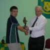 Patrick receives his award from Club President Moss Doody