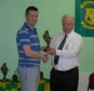 Rory receives his award from Club President Moss Doody