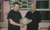 Francis Kiely receives his player of the year award for season 2006/07 from Club President Moss Doody.