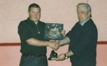 Patrick Kenrick receives his player of the year award from Moss Doody