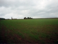 The grass begins to show on the new surface. Ballingarry church can be seen in the distance.