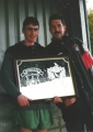 Padraig Forde receives his award from Chairman Benjy Kelly on scoring his 100th competitive goal for the club. Taken 16th April 2000.
