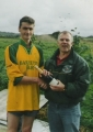 Padraig Forde receives a bottle of champagne from secretary James Clancy after equalling the club record of 114 competitive goals v Ferry Rangers in the Munster Junior Cup Round 1, 7th October 2001.Padraig Forde receives a bottle of champagne from secretary James Clancy after equalling the club record of 114 competitive goals v Ferry Rangers in the Munster Junior Cup Round 1, 7th October 2001.