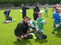 Sean presents ball, bag and cert on last day of camp