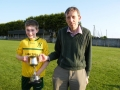 Captain Brian Sheehy receives cup from LDSLs John Phillips