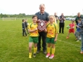 Joint captains Abbie Clancy and Shannon Carey receive shield from Pat Mulvihill LDS-SL