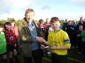 Captain Calvin Quinn receives cup from John Phillips LDS-GL.