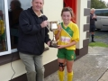 Captain Nessa receives cup from P. Mulvihill, LDSGL
