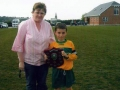 Captain of Under 10 B Team Mikey Hickey receives trophy from Margaret Stokes.