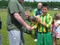 Captain Mark O'Kelly accepts cup from Seamus O'Donnell