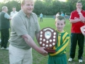 Captain Richie O'Keeffe accepts the Division 1 Shield from LDSL Chairperson Seamus Kelly.