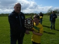 LDSL rep John Cahill presents shield to captain Cathal McMahon