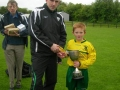 Captain Darren Bridgeman receives cup from Tom Ambrose